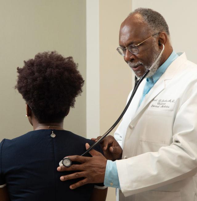 USA Health's Dr. Errol Crook treats a patient.